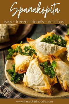Spanakopita triangles are simpler to make than you think! So much flavor from the spinach filling that's perfect with the crispy phyllo dough. And the can be frozen so you can pop just a few in the oven anytime! These little bites are the perfect hand-held greek spinach pies, perfect for dinner or a party. #spanakopita #spanikopita #thewickednoodle #greekappetizers Greek Appetizers, Yummy Appetizers, Appetizer Recipes, Dinner Recipes, Greek Spinach Pie, Spinach And Feta, Cheese Pie Recipe, Greek Salad Recipes, Greek Dishes