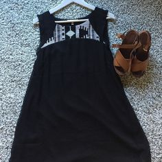 Boutique bought worn once black tribal print dress WORN ONCE, adorable black shift dress. Float shape with a cool and fun tribal print pattern at top on the back and the front. Pair with stewpot wedges for dinner during spring break! Size small but could easily fit medium (6-8) Under skies Dresses Mini
