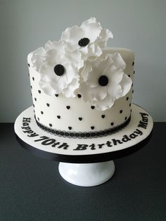 Black and white anemone 70th birthday cake