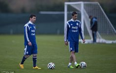 Messi trains alongside Manchester United's £60million signing Angel di Maria at Manchester...
