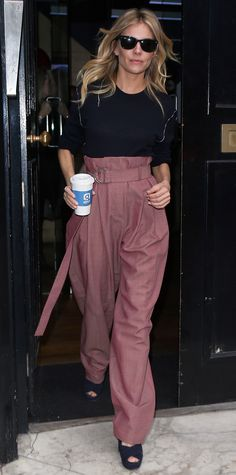 Sienna Miller showed us how to work a paperbag-waist pants like a pro while out on a coffee run, taking her mauve pair and styling it with a navy knit and platform sandals.