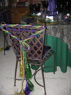Elegant central folders for Mardi Gras table I had to use these sturdy steel chairs loaded with fun Mardi Gras … Source For more pins visit our homepage Mardi Gras Centerpieces, Mardi Gras Decorations, Birthday Party Centerpieces, Table Centerpieces, Birthday Party Themes, Decoration Party, Dinner Themes, Mardi Gras Party, Masquerade Party