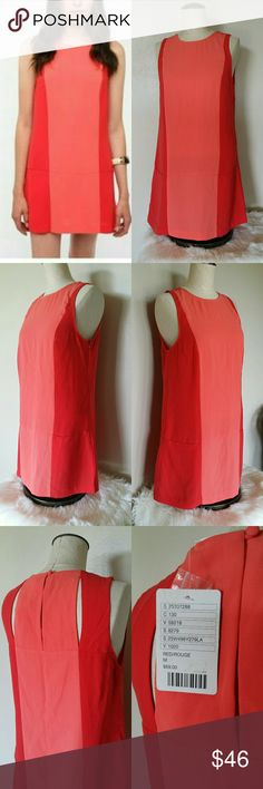 NWT 🍁Urban Outfitters🍁 Color Block Dress Size medium COOPERATIVE  NWT Coral/red color block dress  fitted non stretchy material Very Classy and perfect for fall.   Bundle with another item from my closet for a private offer 😊  No Trades 😊 Urban Outfitters Dresses