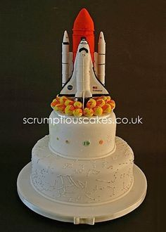 Outer space wedding cake. Spaceship cake topper, solar system middle tier and stars / constellation bottom layer. Pretty! Cake Wrecks - Home - Sunday Sweets... In... SPAAAACE!