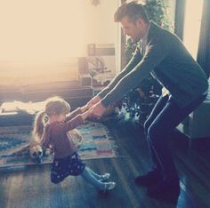 daddy dancing with his daughter..