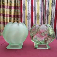 Two green Bagley Equinox vases - one frosted, one clear. You can see that they were hand finished because one is shorter than the other.