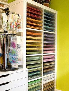 I would LOVE to have some way to organize my scrapbooking supplies like this (or to even have that much cardstock to choose from!)