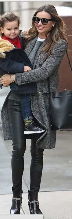 Miranda Kerr: Pants – Helmut Lang  Bracelet – MCS Elena  Sunglasses – Celine  Shoes and coat – Saint Laurent  Purse – Mansur Gavriel