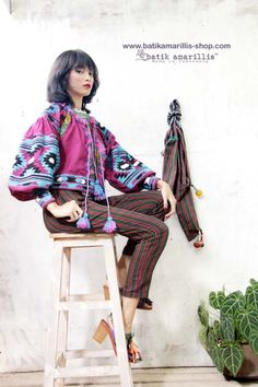 Batik Amarillis's Vasylysa  jacket started availabe at Batik Amarillis webstore:www.batikamarillis-shop.com on August 12  Jacket,linen blend jacket which  takes its cues from the traditional Ukrainian's costume known for its intricate embroidery & billowing silhouette. Cut for a loose fit, this comes with peasant-style details. Balloon sleeves are decorated with geometric  Ukrainian embroidery stye also highlighted with Batik Wonogiren of Indonesia plus soft pompom tassels