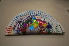 Paper Plate Shaker Musical Instrument Craft: Large Paper Plate, Crayons/Markers/Stickers, Stapler, Dried Beans