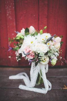 Daisy, rose, baby's breath, tulips - perfect #bouquet for a boho-inspired wedding.   Read More: http://www.stylemepretty.com/2014/06/25/bohemien-inspired-barn-wedding/