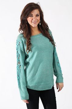 """Bare Arms Sweater, Blue $38.00  OMG, how amazing is this top? The lightweight sweater has metallic thread throughout and has a simple cut that makes way for the real selling point: the cutout embroidery down the sleeves. So beautiful!   Fits true to size. Miranda is wearing a small.   From shoulder to hem:  S/M - 26""""  M/L - 26.5 Mint Julep Boutique, Metallic Thread, Retail Therapy, Blue Sweaters, Tanks, Style Me, Fashion Beauty, Swimsuits, Pullover"""