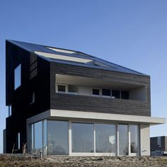 Dutch studio Knevel Architecten completed this villa located on IJburg, a residential district in Amsterdam built on a series of artificial islands.