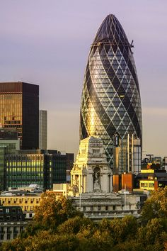 The Gherkin - London < Stripes are solar panels, to warm in winter & cool in summer / SS