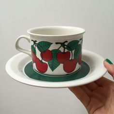 Arabia of finland Kirsikka Tea cup and saucer designed by Inkeri Leivo in the Cherry Arabia of finland ARABIA Made in Finland Arabia Kirsikka (Cherry) Tea cup and saucer by Inkeri Leivo. Available in my shop now at Etsy. Cup And Saucer, Finland, 1970s, I Shop, Tea Cups, Cherry, Canning, Tableware, How To Make