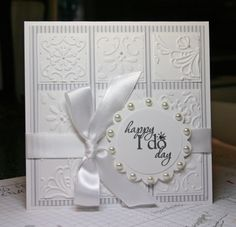 embossing inch square background - very cool.  though I think i'd have to make the bow go the other way...just me!