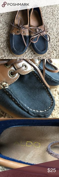 Navy blue and brown boat shoes Navy and brown boat shoes. Only worn a few times Aldo Shoes Flats & Loafers