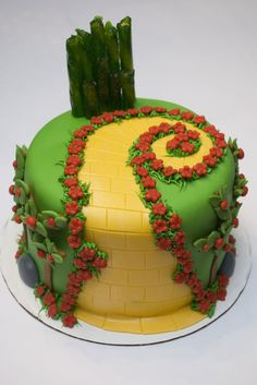 wizard of oz cake- can try with starburst yellow, red poppies and emerald city from melted jolly ranchers and or green licorice