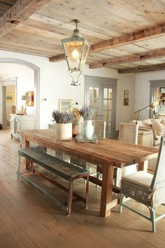 Shabby chic , love the mix of textures...no wicker but maybe dual benches, chairs at the end...no tear drop light...longer, softer piece. And LOVE the wood ceiling, exposed beams!!!