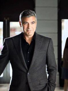 George clooney in black shirt and dark grey suit more
