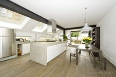 A spacious white renovated house opposite Regents Park with a knock through living room, four bedrooms and a large kitchen which opens onto the garden.