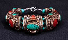 Contemporary handmade bracelet from Kathmandu, Nepal   Silver, turquoise, amber resin and apricot coral