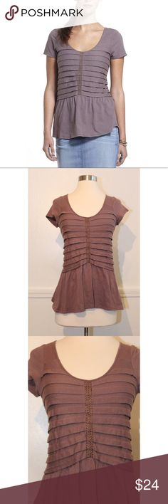 "Ric Rac Sz XS Anthro Stacked Pleats Peplum Top EUC Anthropologie Ric Rac Sz XS Stacked Pleats Peplum Tee TopIn Purple (plum) color with cap sleeves, stacked pleats and peplumFits true to size100% CottonLength: 24""Bust: 14.5""Pre owned good condition-does have slight fading100% CottonEmbroidered bronze stitching on the front Anthropologie Tops Blouses"