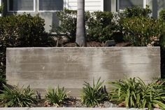 Board formed concrete - texture like this but with a warmer brown tone