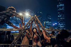 Umbrella Revolution Hong Kong, Pro-democracy protesters take over the outside of Hong Kong's Chief Executive C.Y. Leung's office on October 14, 2014 in Hong Kong. Pro democracy supporters continue to occupy the streets surrounding Hong Kong's Financial district after talks broke down with the government. (Photo by Thomas Campean/Anadolu Agency/Getty Images)