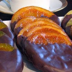 Handmade candied orange slices dipped in dark chocolate by Littlejohn's Candies. Jam Recipes, Greek Recipes, Gourmet Recipes, Healthy Recipes, Fruit Recipes, Midevil Food, Kolaczki Recipe, Candied Orange Slices, Chocolate Dipped