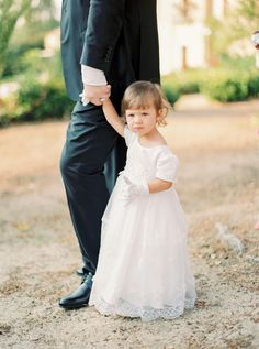 This cutie and her little white gloves! http://www.stylemepretty.com/2015/10/02/romantic-elegant-sicilian-wedding/ | Photography: Yaroslav & Jenny - http://www.yaroslavandjennyphotography.com/