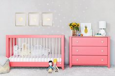 Pink crib and dresser in child's room