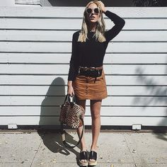I just reacted to A Suede Skirt, a Black Top, a Belt, and Platform Sandals. Check it out!
