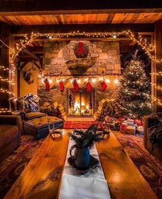 in a Cabin with a warm, cozy fireplace.Christmas in a Cabin with a warm, cozy fireplace. Why do we work so hard to make getting home simple? 🤔 Because it's where we eat together, of course! Cozy Christmas, Country Christmas, Christmas Fireplace, Christmas Stockings, Cabin Christmas Decor, Livingroom Christmas Decor, Christmas Decorations For The Home Living Rooms, Christmas Trees, Christmas Lights