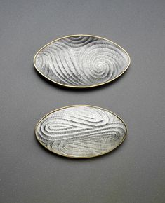 Wayne Victor Meeten  Two Oval Brooches Britannia Silver hand fluted with Yellow gold gilding.