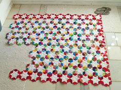 English paper piecing – star layout with tumbling blocks as a secondary design