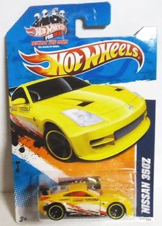 """2011 Hot Wheels NISSAN 350Z YELLOW Nightburnerz series 2 of 10, #112 by Mattel. $7.95. 1:64 scale. die cast metal and plastic parts. ages 3+. Yellow exterior with paint streak designs in red, black and white. Has small tampos: """"Fukuoka Filters"""" """"Leeway Motorsports"""" and """"IMAI"""". Black spoiler with yellow lined wheel rims. Interior is red, grey colored base with red hot wheels logo shape."""