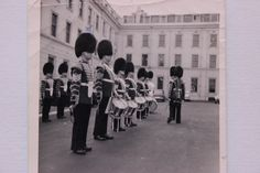 Tom Cornall, virtually hidden from view behind Sgt. Lippiatt, inspecting the Third Battalion Corp. of Drums in Wellington Barracks