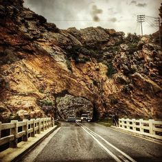 COGMANSKLOOF TUNNEL   MONTAGU  Day 4 #challengeonnaturephotography  Cogmanskloof Pass connects the towns of Ashton and Montagu.  The original route through the mountain included two  dangerous river crossings (Kingna River) and so following a few disasters famed road and pass builder Thomas Bain was commissioned to build the pass through Cogmans Kloof in 1877.  Using a combination of dynamite and gunpowder (gunpowder because dynamite was apparently relatively new and they quickly ran out of…