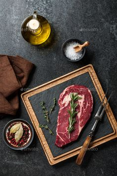 Raw rib eye steak, spices and fork by ff-photo. Raw rib eye steak, spices and fork Steak Spice, Beef Steak, Beef Ribs, Rib Eye Steak, Raw Food Recipes, Meat Recipes, Bbq Roast, Steak And Ale, Food Graphic Design
