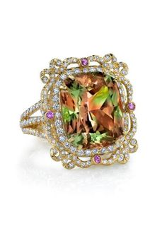 """Erica Courtney's 18k rose gold size 7 ring set with a 19.19ct Zultanite stone. This unique piece measures 1"""" long & is pave set with 1.98ctw diamonds & features 4 pink sapphires = .31ctw"""