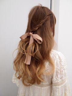 loose braids and bow. so feminine