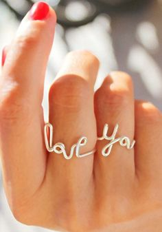 "Even those little fingers can be stylish too. This adorable ring set has cute ""Love"", ""You"" and heart shapes wire ring messages. 