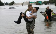 PHOTO: Houston Police SWAT officer Daryl Hudeck carries Catherine Pham and her son Aiden after rescuing them from their home surrounded by floodwaters from Tropical Storm Harvey, Aug. in Houston. (David J. In Dubai, Design Shop, House Design, Vancouver, 13 Month Old, Best Office, Houston Police, Gender Studies, American Red Cross