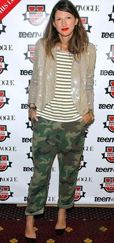 Jenna Lyons. Camo pants, striped top. Sequined jacket.