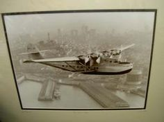 Three Historical Photographs including this: China Clipper: The China Clipper passes over the San Francisco waterfront. The aircraft completed the trip in six days, with a flying time of 59 hours, 48 minutes. Overnight stops included Honolulu, Midway, Wake Island, and Guam.