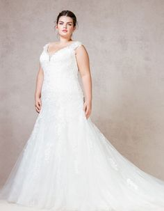 Wow Your Guests In This Sophisticated Tulle And Lace Fit Flare Gown The Beaded Neckline Adds Perfect Touch Of Sparkle On Wedding Day