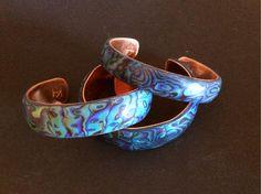 Polymer clay faux paua shell cuff bracelets by Karen Brueggemann.