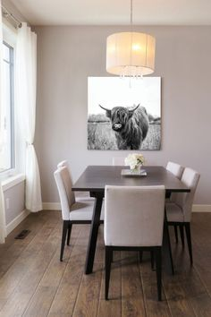 Black and white highland cow chewing grass art in a unique square size. Printable and very cost-friendly for an easy update to your home decor.
