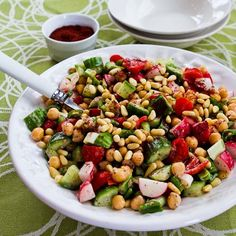 Fattoush-Inspired Chopped Salad with Tahini-Buttermilk Dressing, Chickpeas, Sumac, and Pine Nuts is a healthy meal with some of my favorite flavors. [from Kalyn's Kitchen] #SouthBeachDiet #GlutenFree